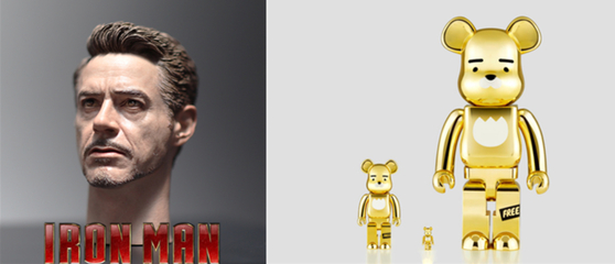 Left: head figure action of Tony Spark from Iron Man, which was jointly created by Korean artists Kim Yong-kyum and Choi Ye-lim. Right: Ryan Bearbrick 1000%, the collaborated item between Kakao and Bearbrick. [BUNGAEJANGTER]