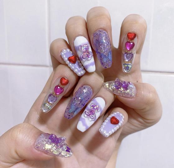 Twenty-three-year-old Lee Ji-eun from North Gyeongsang does her own nails. [LEE JI-EUN]