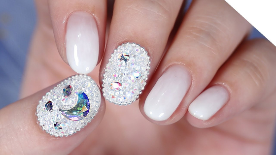 Pixie stone nails is a new trend whereby the nails are covered with tiny crystals. [SCREEN CAPTURE]