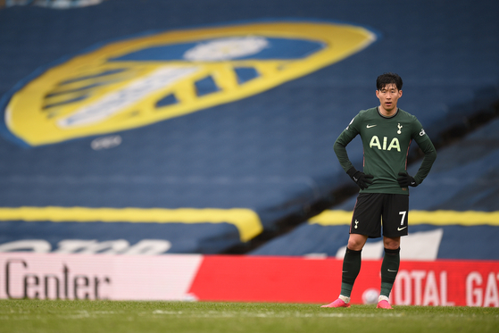 Tottenham's Son Heung-min reacts after Spurs lose 3-1 to Leeds United in Leeds, England on Saturday. [EPA]