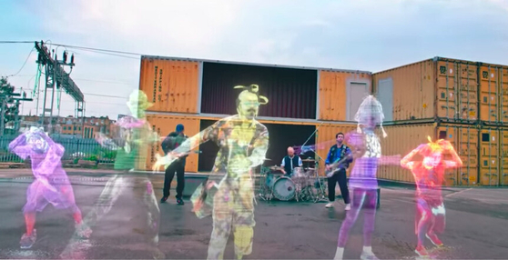 """British rock band Coldplay performs """"Higher Power,"""" joined by the dancers from Ambiguous Dance Company. The music video was released Friday via the rock band's official YouTube prior to their live performance during the 2021 Brit Awards in London on May 11. [WARNER MUSIC KOREA]"""