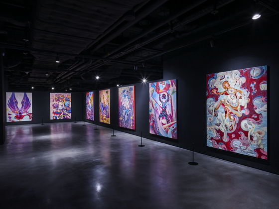 """""""Seven Phases"""" is a section filled with works of art by esteemed illustrator James Jean that have been inspired by BTS and its seven members. There are seven woodcarving installations and seven illustration pieces that symbolize each member. [HYBE]"""
