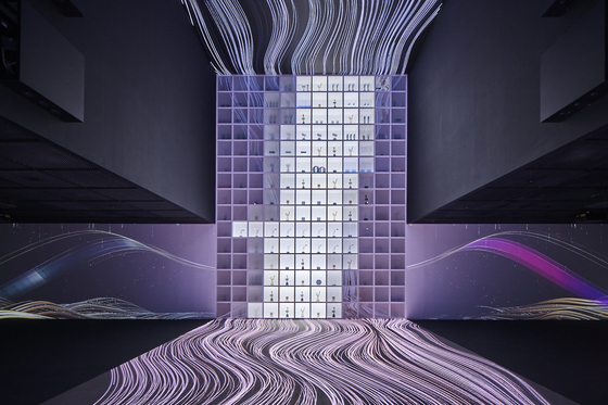 The ″HYBE Music″ section is a room with light projected onto the walls, ceiling and floor, to give an overwhelming visual experience as if stepping into a whole new digital world. A 7-minute video on the history of HYBE and its artists is played, during which an 8.5-meter- (28-foot)-high wall filled with trophies earned by HYBE's artists is lighted. [HYBE]
