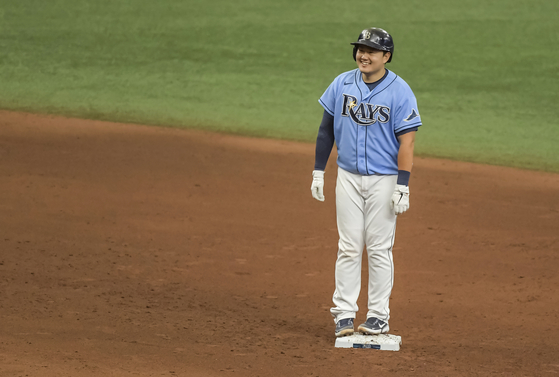 Tampa Bay Rays' Choi Ji-man smiles at second base after hitting an RBI-double off New York Mets reliever Edwin Diaz during the eighth inning in St. Petersburg, Florida on Sunday. [AP/YONHAP]