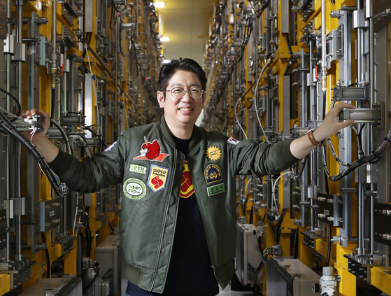 KEIL CEO Kim Young-wook poses by an ″egg tower″ for mealworm cultivation at the company's factory in Osong, North Chungcheong. [PARK SANG-MOON]