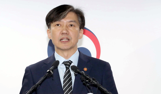 In this file photo, Justice Minister Cho Kuk announces measures to reform the prosecution including new press guidelines on Oct. 8, 2019. [YONHAP]