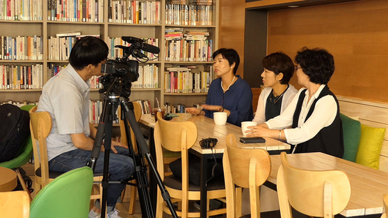 A still image from the film ″A Long Way to School″ shows parents of children with disabilities being interviewed to raise awareness on the issues they face. [JINJIN PICTURES]