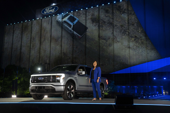 In a photo provided by Ford, Linda Zhang, F-150 Lightning chief engineer, explains details of Ford's first all-electric truck at the reveal of the vehicle at Ford headquarters in Dearborn, Michigan, on May 19, 2021. [AP/YONHAP]