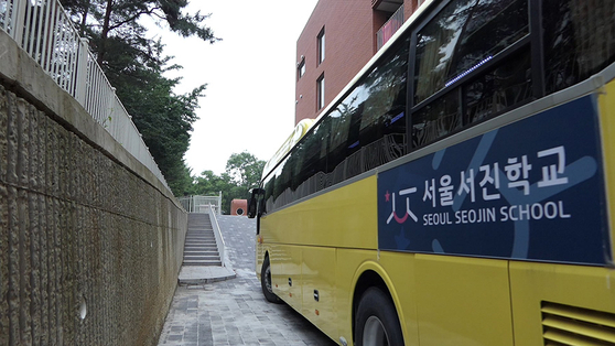 A still image from the film ″A Long Way to School″ shows a shuttle bus of Seojin School running on school days after it opened last year. [JINJIN PICTURES]