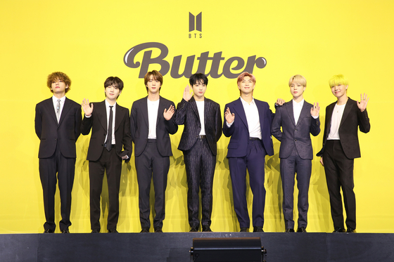 Boy band BTS poses for photos prior to the press conference held on Friday afternoon for its latest digital single ″Butter.″ [BIG HIT MUSIC]