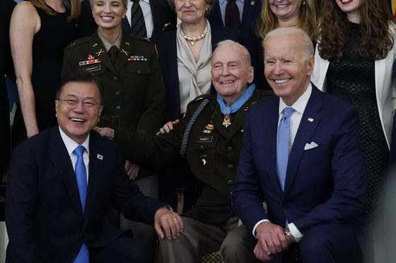 President Joe Biden, right, retired U.S. Army Col. Ralph Puckett, center, and Korean President Moon Jae-in, pose for a photo after Puckett was presented the Medal of Honor in the East Room of the White House on Friday.  [AP]