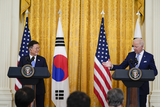 President Joe Biden, right, speaks during a joint news conference with Korean President Moon Jae-in, in the East Room of the White House on Friday in Washington.  [AP]