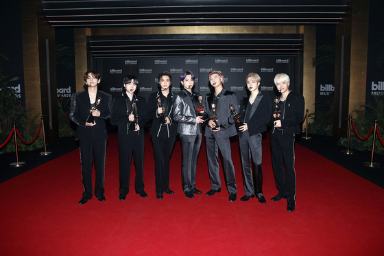 BTS poses for photos for the 2021 Billboard Music Awards on Monday, Korean time. [BIG HIT MUSIC]
