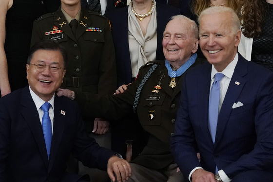 President Joe Biden, right, retired U.S. Army Col. Ralph Puckett, center, and President Moon Jae-in, pose for a photo after Puckett was presented the Medal of Honor at the White House on Friday. Moon was invited to the ceremony to award the highest U.S. military honor to the retired Army officer more than 70 years after leading soldiers through a fierce attack by Chinese forces during the Korean War.  [AP]
