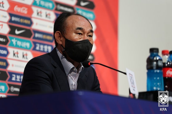 National team coach Kim Hak-bum answers questions at a press conference at the National Football Center in Paju, Gyeonggi on Monday. [NEWS1]