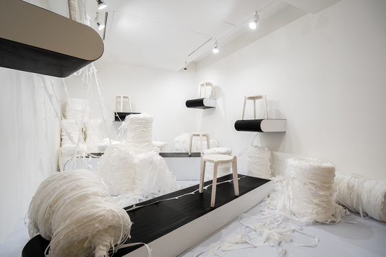 """Designer Kim Ha-neul's """"Stack and Stack (In Pandemic),"""" featuring rolls of plastic fiber used to produce disposable face masks along with stools made from the plastic fiber. [DAELIM MUSEUM]"""