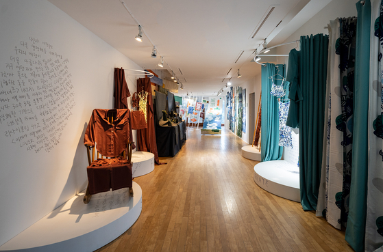 """Dresses and fashion items made with discarded fabric and leftover scraps of cloth in the """"Fabulous Fabric"""" section. [DAELIM MUSEUM]"""