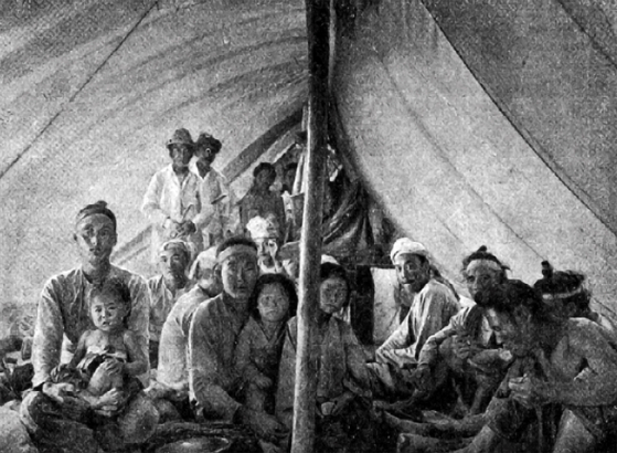 Korean workers in their tent on the railroad construction site. [HUNGARIAN EMBASSY]