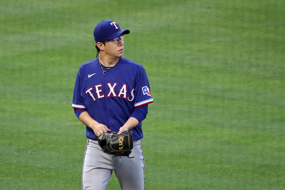 Yang Hyeon-jong of the Texas Rangers looks on at the end of the second inning after giving up a two run homer to Jared Walsh of the Los Angeles Angels at Angel Stadium in Anaheim, California, on Tuesday. [AFP/YONHAP]