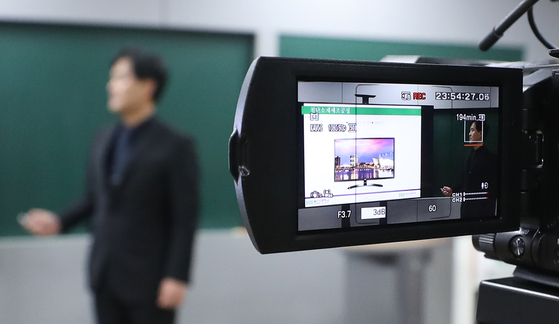 A teacher recording a class to be streamed online in Ulsan in March 2020. [YONHAP]