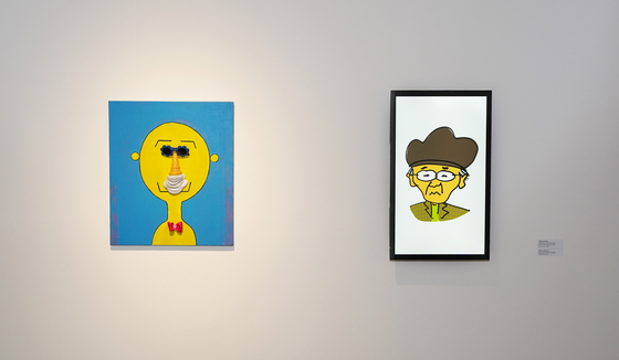 The portrait of Joo Ho-min created by his father Joo Jae-hwan, left, and a portrait of the father illustrated by his son open up the ″Homin and Jaehwan″ exhibition now held at the Seoul Museum of Art. [JEON TAE-GYU]