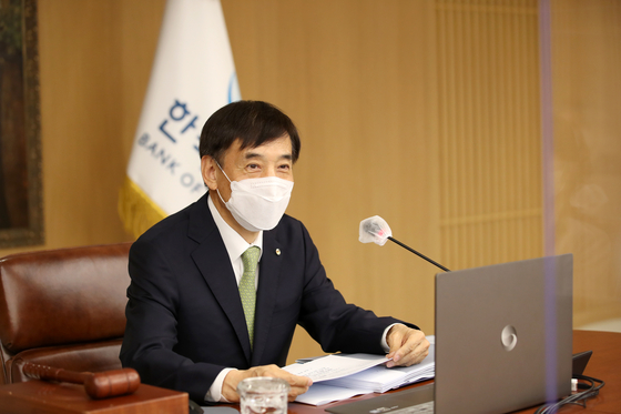 Bank of Korea Gov. Lee Ju-yeol speaks during a monetary policy board meeting held Thursday. The board voted to maintain the base rate at 0.5 percent. [BANK OF KOREA]