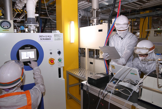 LG Display workers check equipment designed to capture carbon emissions. [LG DISPLAY]