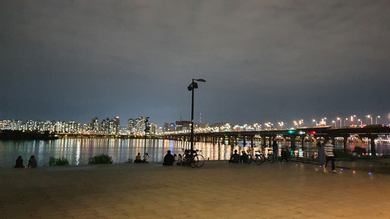 People drink in the Yeouido Han River Park on May 21 around 11 p.m. [HALEY YANG]