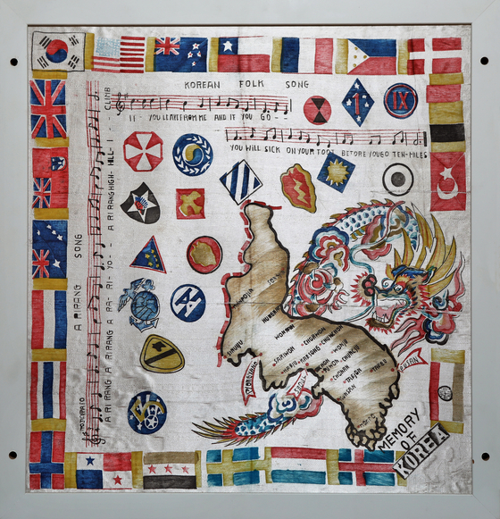 A silk scarf that the United Nations coalition troops took away as a souvenir after the end of the Korean War (1950-1953).  The Score of Korean Folk Song