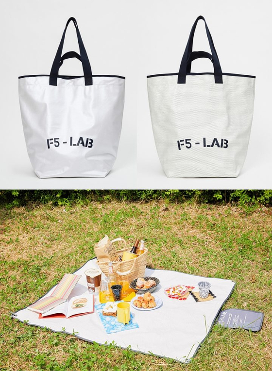 Tote bags and picnic mats made of discarded movie screens by cinema chain CJ CGV in celebration of World Environment Day, which is June 5. [CJ CGV]