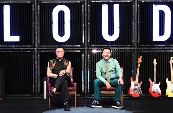 """Producers Park Jin-young, left, and Psy pose for the camera at an online press event for the upcoming SBS survival audition program """"LOUD"""" on Thursday. [SBS]"""