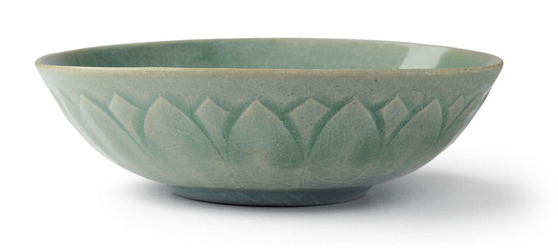 A mid-Goryeo era stoneware bowl with a molded decoration of lotus leaves under a celadon glaze [COREANA COSMETICS MUSEM]