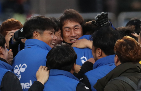 Yoo Sang-chul hugs his team members after Incheon United tied Gyeongnam FC, keeping the Incheon team from being demoted to the second tier league on Nov. 30, 2019. [YONHAP]