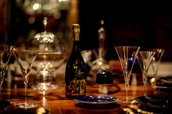 Rare Champagne on a dining table [PIPER HEIDSIECK]