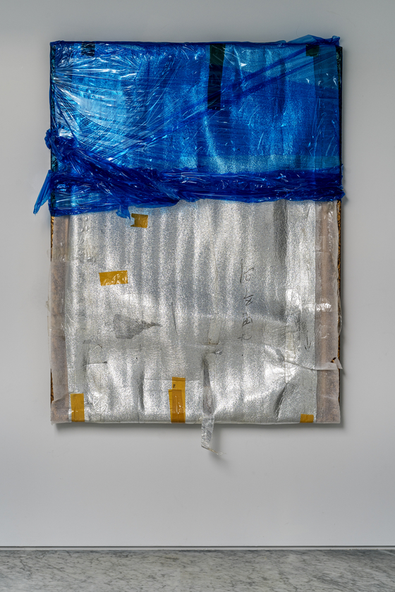 """Bek's mixed media """"Welcome, Welcome!"""" is a wrapped portrait. [PKM GALLERY]"""