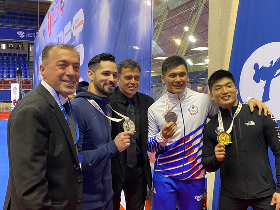 Park Hee-jun celebrates with silver medalist Yi Ta Wang of Taiwan and gold medalist Torres Gutierrez Ariel of the United States at the 2020 Olympic Qualification Tournament in Paris on Saturday. [Korea Karate Federation]