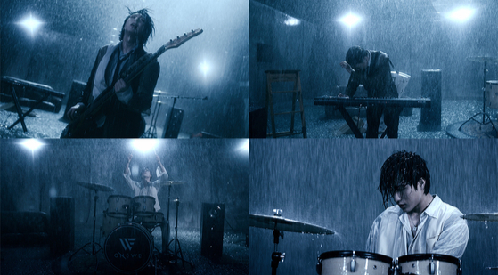 Captured images from boy band Onewe's new track ″Rain To Be″ featuring members of the band singing in the pouring rain. [RBW]