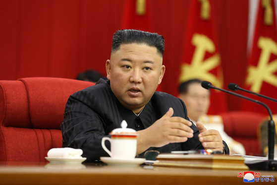 North Korean leader Kim Jong-un at the 3rd Plenary Meeting of the 8th Central Committee of Workers' Party of Korea on Thursday. [YONHAP]