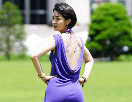 Rep. Ryu Ho-jeong, a lawmaker from the progressive Justice Party, appears wearing fake tattoos at a press conference in the National Assembly on Wednesday. [FACEBOOK]