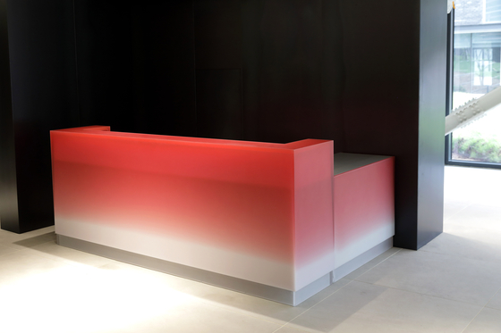 Designer Park Won-min's bright red ombre information desk is made of resin. [SEOUL MUSEUM OF CRAFT ART]