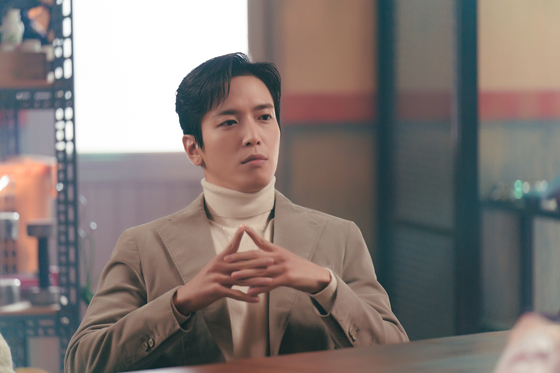 Jung Yong-hwa portrays In-beom, a con-man and a medium who assists exorcist Jia in eradicating spirits who haunt people's homes. [KBS]