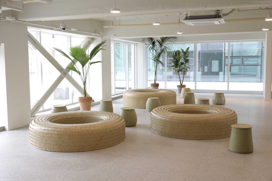 Bamboo craft artist Han Chang-gyun's donut-shaped benches, each woven out of 150 bamboo strips. [SEOUL MUSEUM OF CRAFT ART]