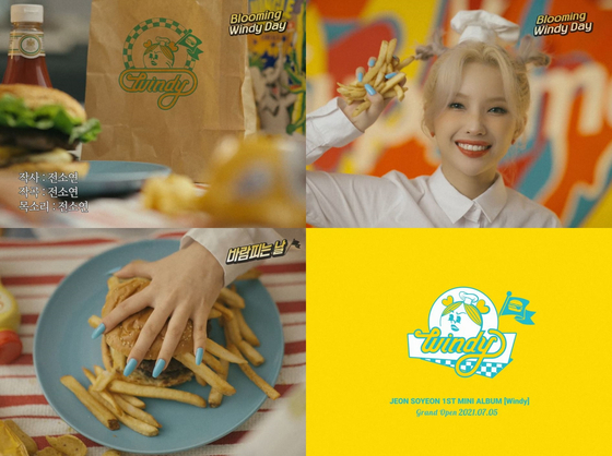 Jeon So-yeon of (G)I-DLE makes a hamburger in theses captured images from her concept video released on Monday. [CUBE ENTERTAINMENT]