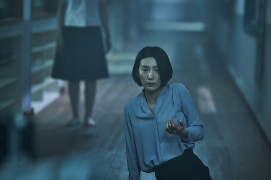 """Kim Seo-hyung portrays Eun-hee, the vice principal of a school in her hometown in Gwangju, still haunted by her memories with her best friend in """"Whispering Corridors 6: The Humming."""" [KTH]"""