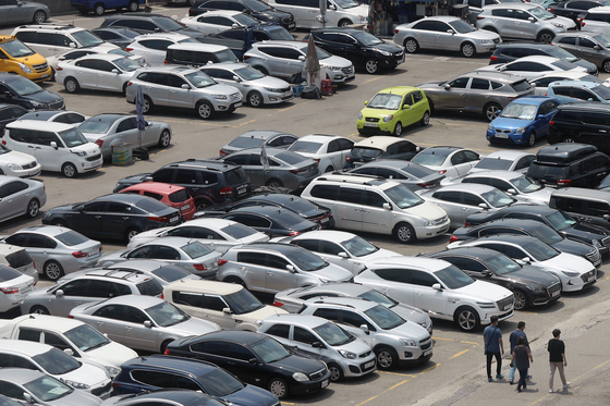 A lot is packed with secondhand cars located in Seongdong District in eastern Seoul on June 13. [NEWS1]