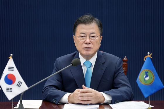President Moon Jae-in speaks at a virtual summit between Korea and the Central American Integration System (SICA) held Friday. [YONHAP]