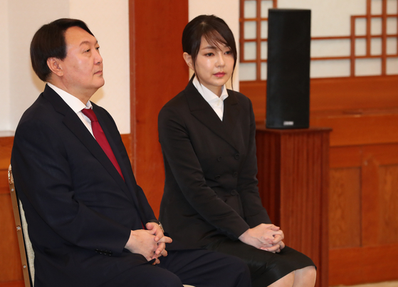 In this file photo, then-Prosecutor General Yoon Seok-youl, left, and his wife Kim Keon-hee wait for President Moon Jae-in before Yoon's credential awarding ceremony at the Blue House on July 27, 2019. [PRESIDENTIAL PRESS CORPS]