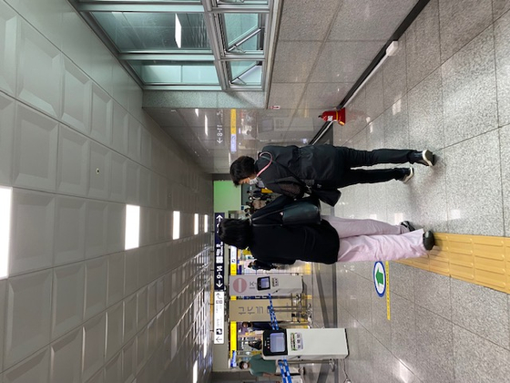 Engelstoft, with Lee, walking in a subway station in Daegu on June 24. [NATIONAL CENTER FOR THE RIGHT OF THE CHILD]