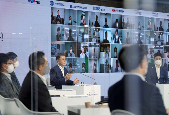 President Moon Jae-in speaks at an event reviewing the outcome of the second year of Japan's export curbs on Korea at Coex in Gangnam District, southern Seoul, on Friday, attended by representatives of the materials, components and equipment sector. [JOINT PRESS CORPS]