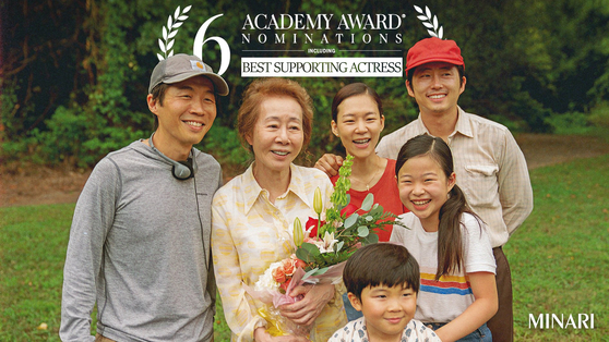 From left, Director Lee Isaac Chung and actors Youn Yuh-jung, Han Ye-ri and Steven Yeun with child actors Alan Kim and Noel Kate Cho [PAN CINEMA]